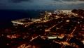 illuminated seaside in night in Barcelona - blurred image  77242854