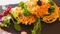 fried carrots cutlets with greens served at plate on table 77255908