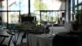 Luxurious restaurant. Luxurious interior, white tables, serving dishes and glasses for guests 77262385