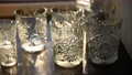 Beautiful luxury empty crystal glasses stand on the table against the background of the sun rays 77269480