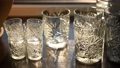 Beautiful luxury empty crystal glasses stand on the table against the background of the sun rays 77269481