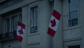 Canadian Flags On Building In The Evening 77277905