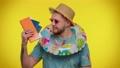 Summer vacation, journey, traveler tourist bearded adult man celebrating, holding passport, tickets 77307532