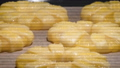 4K Time Lapse of baking of pineapple puff pastry rings in oven 77312744