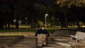 Handicapped boy in wheelchair in the park in late evening 77322081