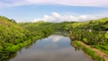 Countryside on a large tropical island. Small village on the green hills by the river. The nature of the Philippines, Samar 77334455