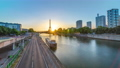 Eiffel Tower sunrise timelapse with boats on Seine river and in Paris, France. 77367514