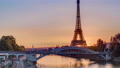 Eiffel Tower sunrise timelapse with boats on Seine river and in Paris, France. 77367518