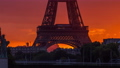 Eiffel Tower sunrise timelapse with boats on Seine river and in Paris, France. 77367531