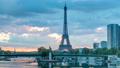 Eiffel Tower sunrise timelapse with boats on Seine river and in Paris, France. 77367532