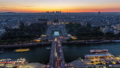 Aerial view over Trocadero day to night timelapse with the Palais de Chaillot seen from the Eiffel Tower in Paris, France. 77367542
