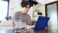 Men shopping online at home 77443498