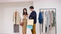 A couple enjoying shopping 77443507