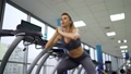 Young sporty Woman On Running Machine In Gym 77449958