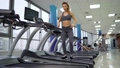 Young sporty Woman On Running Machine In Gym 77449976