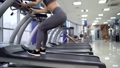 Young sporty Woman On Running Machine In Gym 77450472