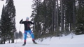 Young woman skiing on a forest trail 77895229