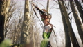 A archer-girl looks around in search of an enemy in a green summer forest. Historical medieval concept. The animation is for historical, medieval or fantasy backgrounds. 78230549