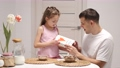 Cheerful little daughter and dad having breakfast 78389878