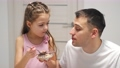 Cheerful little daughter and dad having breakfast 78389879
