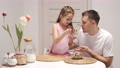 Cheerful little daughter and dad having breakfast 78389880