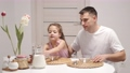 Cheerful little daughter and dad having breakfast 78389884