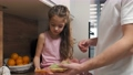 Father and daughter preparing sandwiches on Father's Day 78390031
