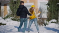 Wide shot of funny couple dancing in snow on winter backyard. Happy cheerful Caucasian man and woman having fun outdoors on sunny day. Leisure and togetherness concept 78448433