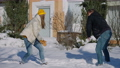 Cheerful laughing millennial couple playing snowballs on winter sunny backyard outdoors. Happy relaxed Caucasian boyfriend and girlfriend having fun. Joy and leisure concept 78448435