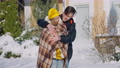 Romantic loving young man wrapping smiling woman with blanket standing outdoors on sunny winter day. Positive happy Caucasian couple enjoying leisure on snowy resort. Tourism and bonding 78448436
