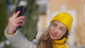 Charming young millennial woman taking selfie on smartphone standing on sunny winter resort outdoors. Close-up portrait of cheerful relaxed smiling lady travelling. Tourism and device addiction 78448443