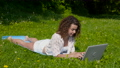 Beautiful girl student working on laptop in the park 78461155