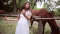 Beautiful woman on the background of a horse. 78492346