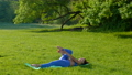 Young beautiful girl doing fitness workout on the grass in the park 78543775