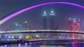 Pedestrian Bridge over the Dubai Water Canal day to night timelapse, United Arab Emirates 78551886