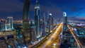 Dubai downtown architecture day to night timelapse. Top view over Sheikh Zayed road with illuminated skyscrapers and traffic. 78551888