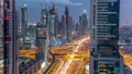 Dubai downtown architecture day to night timelapse. Top view over Sheikh Zayed road with illuminated skyscrapers and traffic. 78551890