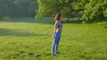 Young beautiful girl doing fitness workout on the grass in the park 78564829