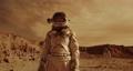 Female astronaut admiring terrain of Mars 78576253
