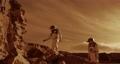 Astronauts climbing rocks and looking away on Mars 78576254