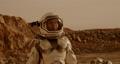 Female astronaut shooting terrain of Mars 78576606