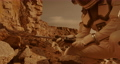 Unrecognizable astronaut analyzing soil of Mars 78576608
