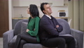 Argued interracial adult couple sitting on couch back to back talking thinking. Sad Caucasian woman and Middle Eastern man quarreling at home in living room. Conflict and relationship problems 78672896