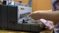 Worker using binding machine in printing office 78722819