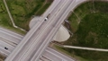 Highway with traffic in the countryside. Suburban broadband lane with cars and trucks. Travel and transportation. Aerial view Bird's eye view. High quality 4k video. 78805696