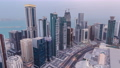 Dubai skyline with Burj Al Arab hotel during sunset and day to night timelapse. 78809449