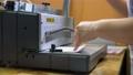 Worker using binding machine in printing office 78922777