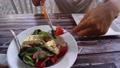 Someone eating greek salad 79257535