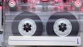 vintage transparent  cassette playing inside of deck 79437254