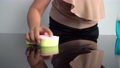 Close-up shot of middle age woman housekeeper wiping table surface with a sponge cloth. 79546017